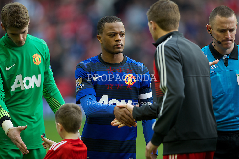 LIVERPOOL, ENGLAND - Saturday, January 28, 2012: Manchester United's Patrice Evra shakes hands with Liverpool's captain Steven Gerrard before the FA Cup 4th Round match at Anfield. (Pic by David Rawcliffe/Propaganda)