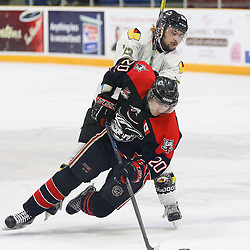 """TRENTON, ON  - MAY 5,  2017: Canadian Junior Hockey League, Central Canadian Jr. """"A"""" Championship. The Dudley Hewitt Cup Game 7 between Georgetown Raiders and the Powassan Voodoos.    Tyson Gilmour #23 of the Powassan Voodoos hits Austin Cho #20 of the Georgetown Raiders during the first period<br /> (Photo by Alex D'Addese / OJHL Images)"""