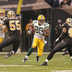2008 November, 24: Green Bay Packers running back Ryan Grant (25) runs between Saints defenders Roman Harper (41) and Scott Fujita (55) during 51-29 victory by the New Orleans Saints over the Green Bay Packers on Monday Night Football at the Louisiana Superdome in New Orleans, LA.