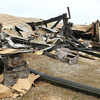 Some remains of furniture sit in the ruins of the American Furniture Plant on Friday afternoon after an announcement made by the ATF that the fire was arson.