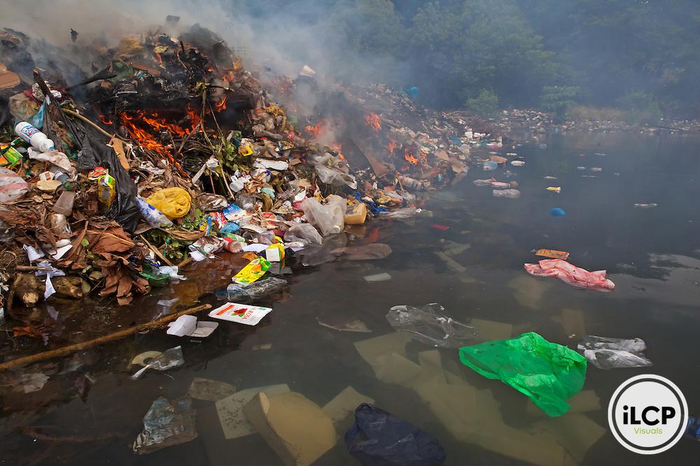 Garbage dump, near Balmoral, Guanaja Island, Bay Islands, Honduras, April