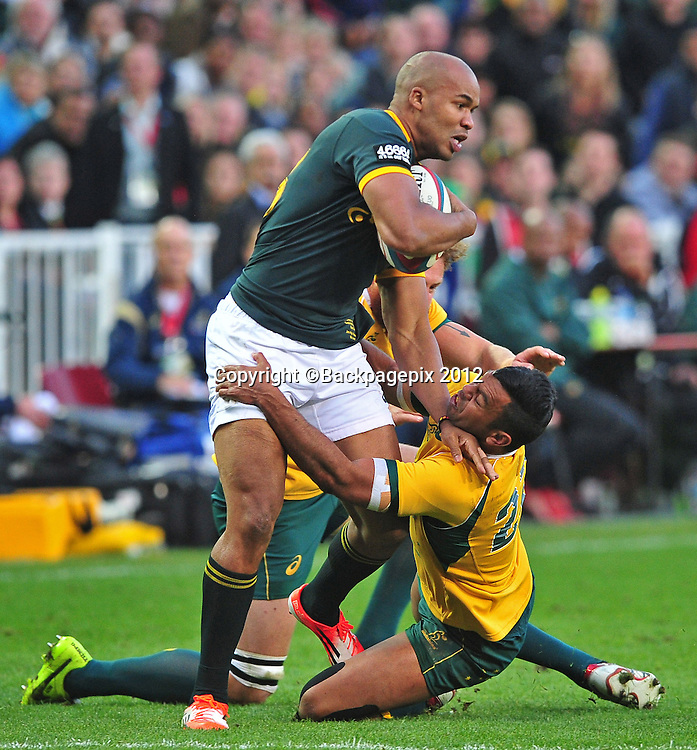 JP Pietersen of South Africa is tackled by Kurtley Beale of Australia during the 2014 Castle Lager Rugby Championship game between South Africa and Australia at Newlands, Stadium, Cape Town on 27 September 2014 ©Ryan Wilkisky/BackpagePix
