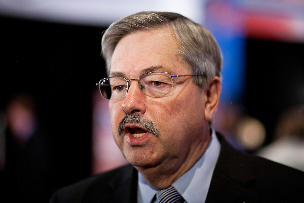 Iowa governor Terry Branstad talks to the media in the spin room following the Republican presidential debate on Saturday, December 10, 2011 in Des Moines, IA.