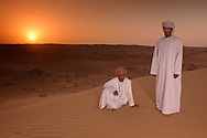 Beduins in Sand Dunes at sunrise, Wahabi Sands near Al Qabil, Sharqiya Region, Oman, Arabian Peninsula