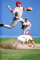 Turning a double play --- Image by © Jim Cummins/CORBIS