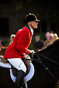 A fox hunter before the start of the foxhunt on the greensward of Charleston Place plantation in Charleston, South Carolina. The hunt is a drag hunt where a scented cloth is used instead of live fox.