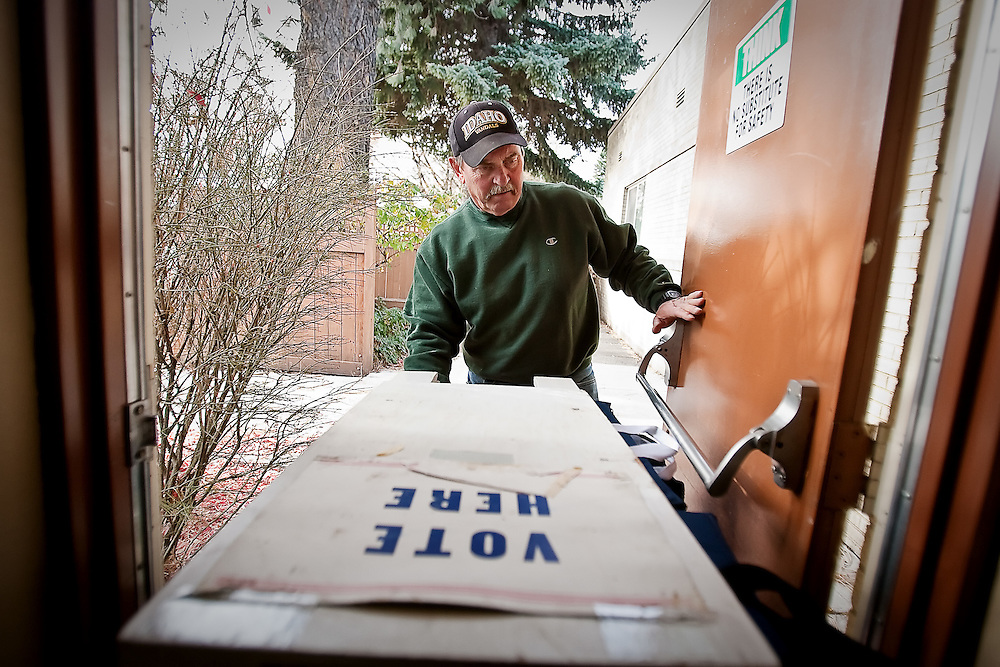 JEROME A. POLLOS/Press..Bob Ries uses a cart to deliver supplies to polling station managers Monday at the Kootenai County Elections Office in Coeur d'Alene in preparation for today's general election.