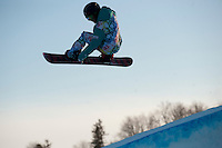Ryo Aono (?) launches off of the half-pipe during a mock olmpic trial organized by the different teams coaches. They are part of an international group of national snowboard teams who gave up the mountains to come to the Otsego Club in mid-Michigan.