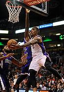 Dec. 17, 2012; Phoenix, AZ, USA; Phoenix Suns forward Michael Beasley (0) makes a pass around the Sacramento Kings forward James Johnson (52) in the second half at US Airways Center. The Suns defeated the Kings 101-90.  Mandatory Credit: Jennifer Stewart-USA TODAY Sports