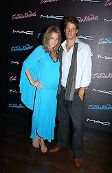 Model NATASHA GILBERT and RYAN KOHN at a party to celebrate Zandra Rhodes's return to London Fashion week and the launch of a limited edition of M.A.C makeup at Silver, 17 Hanover Square, London W1 on 20th September 2006.<br />