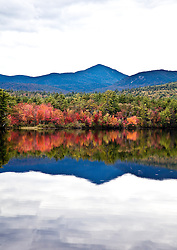 Fall color -- sugar maples -- blaze along on the shores of an unnamed lake, off Highway 113, south of Conway.