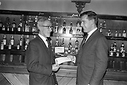 13/02/1963<br /> 02/13/1963<br /> 13 February 1963<br /> Retirement presentation at Gilbeys of Ireland Ltd., Dublin. A presentation of a cheque for £100 and a gold watch was made to Paddy Slater (65), on his retirement after 49yrs and 7 months service with the company. A sum of money was also presented by the staff. Picture shows: Mr. Ian Cairnduff, Director Gilbeys (right) making the presentation to Mr. Slater.