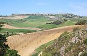 Farming landscape of Rio Setenil valley, Cuevas del Marques, Serrania de Ronda, Spain view to Acinipo Roman hilltop town