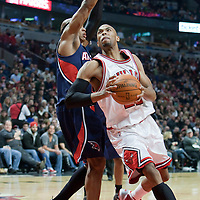 19 December 2009: Chicago Bulls forward Taj Gibson drives past Atlanta Hawks forward Josh Smith during the Chicago Bulls 101-98 victory in overtime over the Atlanta Hawks at the United Center, in Chicago, Illinois, USA.