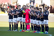 26th December 2017, Dens Park, Dundee, Scotland; Scottish Premier League football, Dundee versus Celtic; Dundee players during applaus for Dundee manager Neil McCann's father, Eddie, who passed away at the weekend