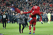 Liverpool defender Virgil van Dijk (4), Liverpool defender Joe Gomez (12) and Liverpool defender Andrew Robertson (26) celebrate the 4-0 victory during the Champions League semi-final, leg 2 of 2 match between Liverpool and Barcelona at Anfield, Liverpool, England on 7 May 2019.