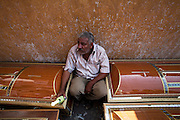 An Egyptian Coptic Christian man sits among caskets for victims October 10, 20011 at the Coptic Hospital in Cairo, Egypt. At least 26 people, mostly Christian,  were killed during sectarian clashes that saw the worst violence since the Revolution that toppled former Egyptian president Hosni Mubarak earlier this year. Egyptian Coptic Christians make up about 10% of Egypt's 80 million population and periodically violence flares between the Christian minority and the majority Muslim population. (Photo by Scott Nelson)