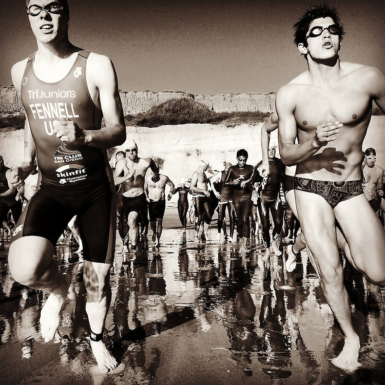Runners heading out in first phase of triathlon in Del Mar, CA