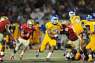 Lafayette High's Chris Stewart (42) vs. Tupelo's Jarvis Wilson (7) in Oxford, Miss. on Friday, August 22, 2014. Tupelo won the season opener 20-0.