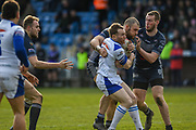 Richard Lepori (2) of Swinton Lions tackled by Alex Susino (17) of Featherstone Rovers during the Betfred Championship match between Featherstone Rovers and Halifax RLFC at the Big Fellas Stadium, Featherstone, United Kingdom on 9 February 2020.