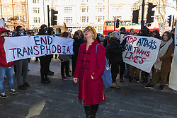 Anti-transgender feminist Venice Allan, 42, poses in front of transgender rights activists as they demonstrate outside Westminster Magistrates' Court to &quot;Free the Shewolf&quot;, Tanis Jacob Wolf / aka Tara Flik Wood who is facing a charge of assault by beating of a 60 year old woman at Speaker&rsquo;s Corner in Hyde Park, London in September 2017.<br /> <br /> Wolf/Wood, 26, entered a plea of not guilty and was bailed to appear at Hendon Magistrates&rsquo; Court in two months&rsquo; time. London, February 15 2018.