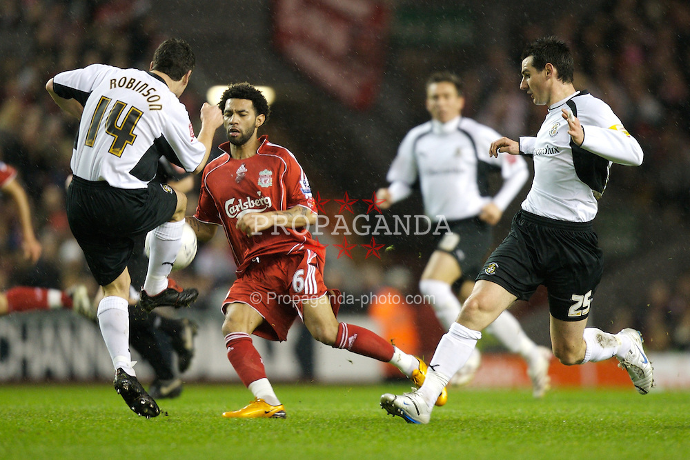 LIVERPOOL, ENGLAND - Tuesday, January 15, 2008: Liverpool's Jermaine Pennant and Luton Town's Steve Robinson during the FA Cup 3rd Round Replay at Anfield. (Photo by David Rawcliffe/Propaganda)