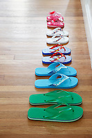 Row of flip-flops on floor elevated view