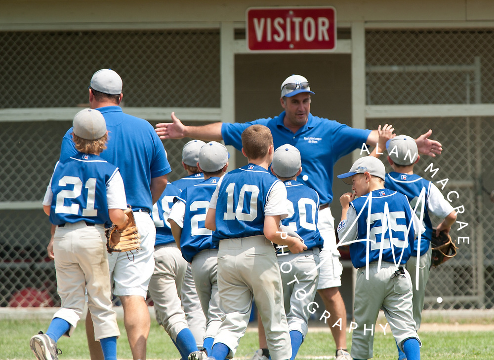 Rye's 9 & 10 year old Little League All Stars get a round of high fives from their coach after defeating Portsmouth in game 1 of the championship series at Colby Field in Laconia on Saturday, July 17, 2010.  (Alan MacRae/for the Citizen)