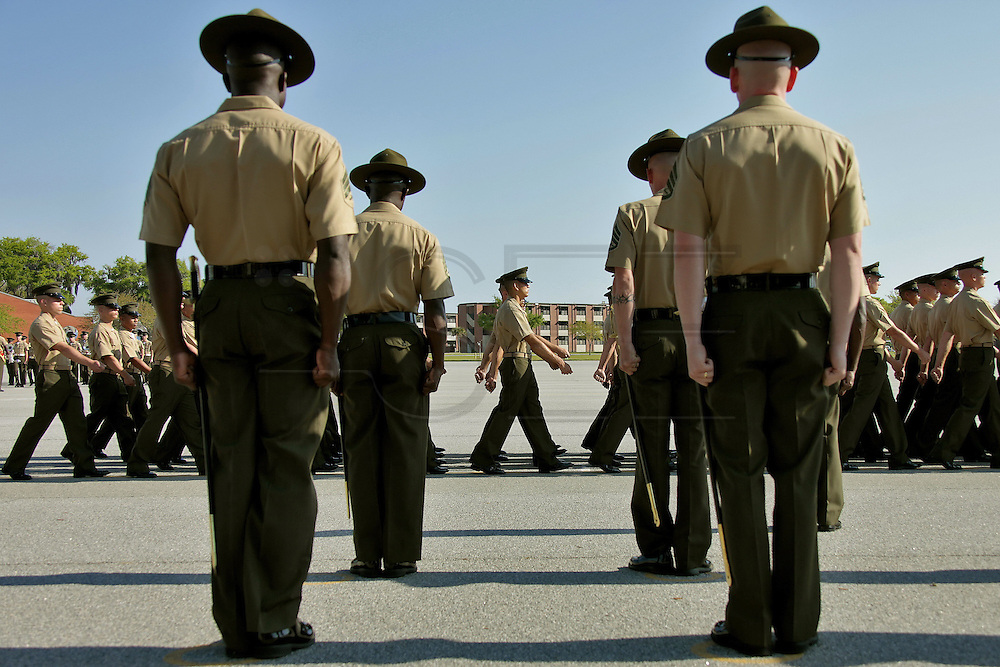 New marines file past their drill instructors during the graduation ceremony.  Marine Corps Recruit Depot at Parris Island in South Carolina is where all male recruits living east of the Mississippi River and all female recruits from all over the US receive their arduous twelve week training in their quest to become marines. Even though there are two current active wars and a weak economy, recruitment has not been effected.  Actually, recruiting numbers have increased, with more young men and women looking toward the military for answers.