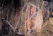 "Complex pictograph with petroglyohs, estimated to be 2000 - 3000 years old in the Columbia River Gorge National Scenic Area, Oregon. Native people who live in the area refer to the creators of the rock art in the Columbia River area as the ""River People"". Much of the original rock art in the area has been flooded by hydro projects or vandalized, but there remain some prinstine examples in out of the way areas."