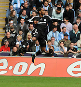 Didier Drogba celebrates scoring the first goal during the FA Cup Sponsored by E.ON 6th round match between Coventry City and Chelsea at the Ricoh Arena on March 7, 2009 in Coventry, England.