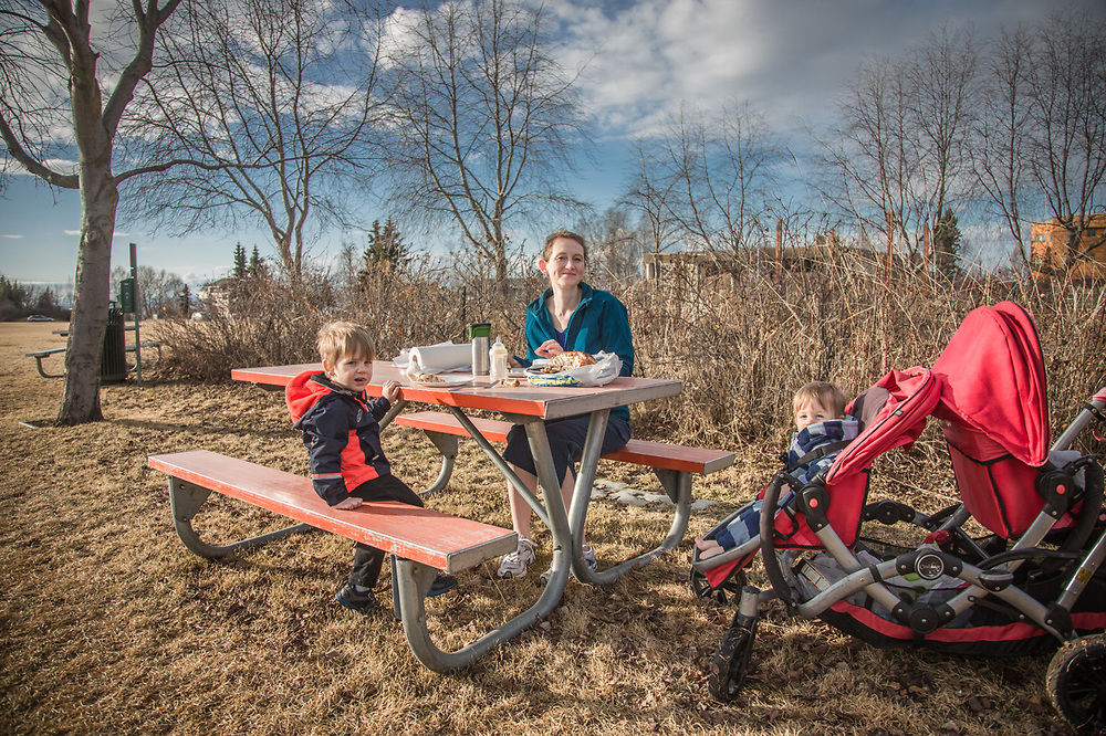 """Its March, this is our first picnic of the year, and Ian has kicked his socks off!""  -Ilona Leider with her sons Isaac (2.5) and Ian (10 months) on an unseasonably warm evening at the west end of the Delaney Park Strip in Anchorage.  imbarber@hotmail.com"