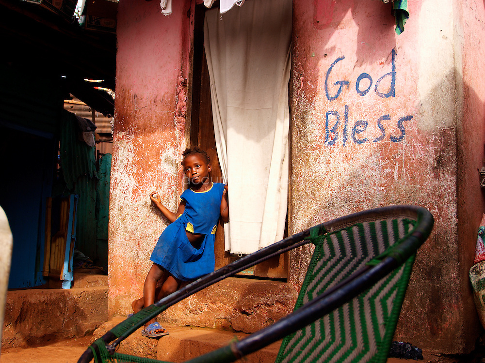 A girl stands by her house in a Freetown slum, Kroo Bay, Freetown, Sierra Leone.