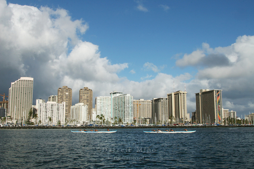 Feb 25, 2007; Honolulu, HI - A view of Waikiki with white puffy clouds taken from Ala Moana Beach Park as paddlers in outrigger canoes paddle through Ala Wai Harbor...Hawaii Prince Hotel, Ilikai, Hilton Hawaiian Village...Photo credit: Darrell Miho