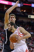 Nov 29, 2013; Houston, TX, USA; Houston Rockets small forward Omri Casspi (18) drives against Brooklyn Nets center Brook Lopez (11) during the second quarter at Toyota Center. Mandatory Credit: Thomas Campbell-USA TODAY Sports