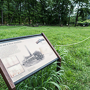 A sign explains the archeological site where the armoury once stood at Harpers Ferry, West Virginia.