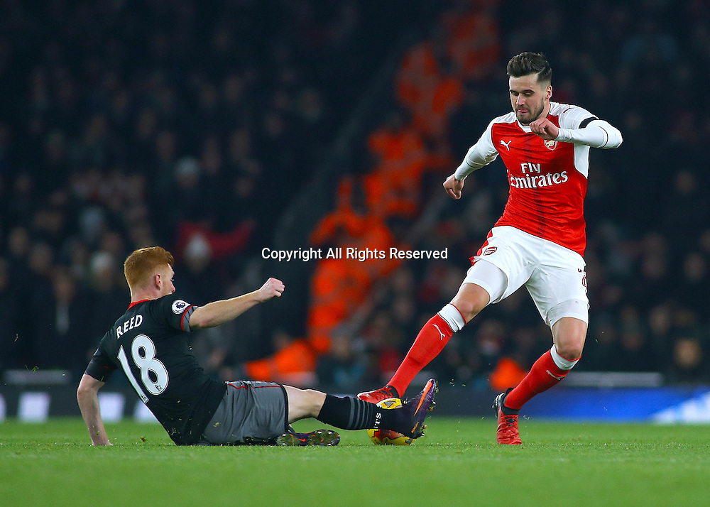 30.11.2016. Emirates Stadium, London, England. EFL Cup Football, Quarter Final. Arsenal versus Southampton. Arsenal Defender Carl Jenkinson is dispossessed by Southampton Midfielder Harrison Reed during an Arsenal push