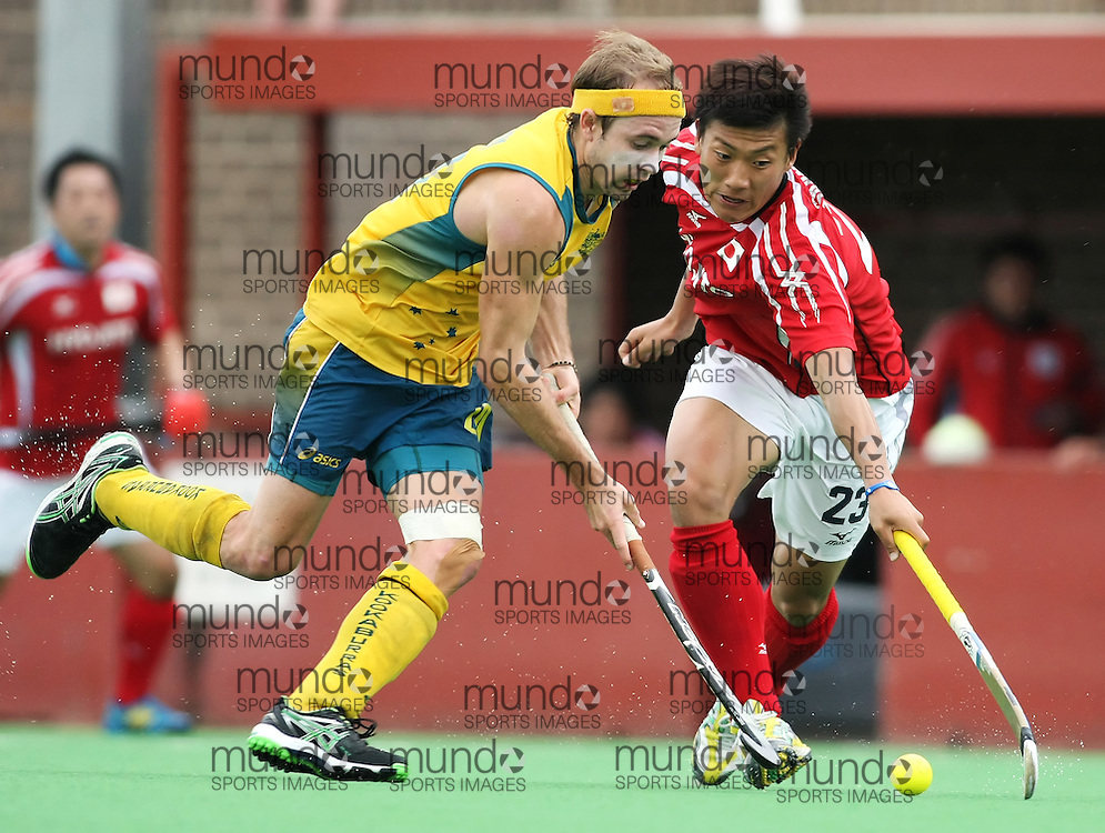 (Canberra, Australia---01 April 2012) Matt Swann of the Australia Kookaburra national field hockey team and Hiroki Sakamoto of Japan during play against Japan in the third of a three game field hockey test series. Australia won the game 7-1 and the series 3-0. Copyright Photograph Sean Burges / Mundo Sport Images, 2012.