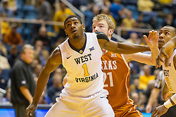 Jan 20, 2016; Morgantown, WV, USA; West Virginia Mountaineers forward Jonathan Holton (1) boxes out Texas Longhorns forward Connor Lammert (21) during the first half at the WVU Coliseum. Mandatory Credit: Ben Queen-USA TODAY Sports
