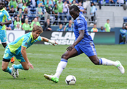 July 18, 2012: CenturyLink Field, Seattle, WA: Chelsea FC Romelu Lukaku takes a shot on goal as Sounders Jeff Parke tries to block the ball during the World Football Challenge. Chelsea FC defeated the Seattle Sounders 4-2.