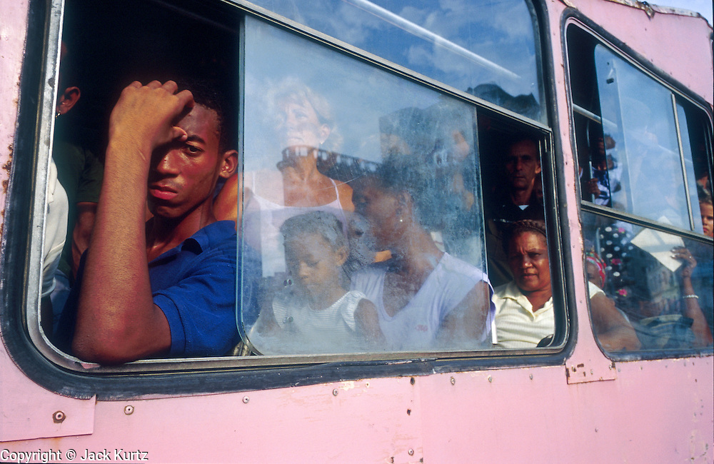 "25 JULY 2002 - HAVANA, HAVANA, CUBA: People ride a ""camello"" or camel bus, so called because of its distinctive hump backed shape in Havana, Cuba, July 25, 2002..PHOTO BY JACK KURTZ"