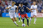 CHICAGO, IL - AUGUST 02: Real Madrid midfielder Marcos Llorente (18) and MLS All-Star and Atlanta United FC Midfielder Miguel Almiron (26) battle for the ball in the second half during a soccer match between the MLS All-Stars and Real Madrid on August 02, 2017, at Soldier Field in Chicago, IL. The game ended in a 1-1 tie with Real Madrid winning on penalty kicks 4-2. (Photo By Daniel Bartel/Icon Sportswire)