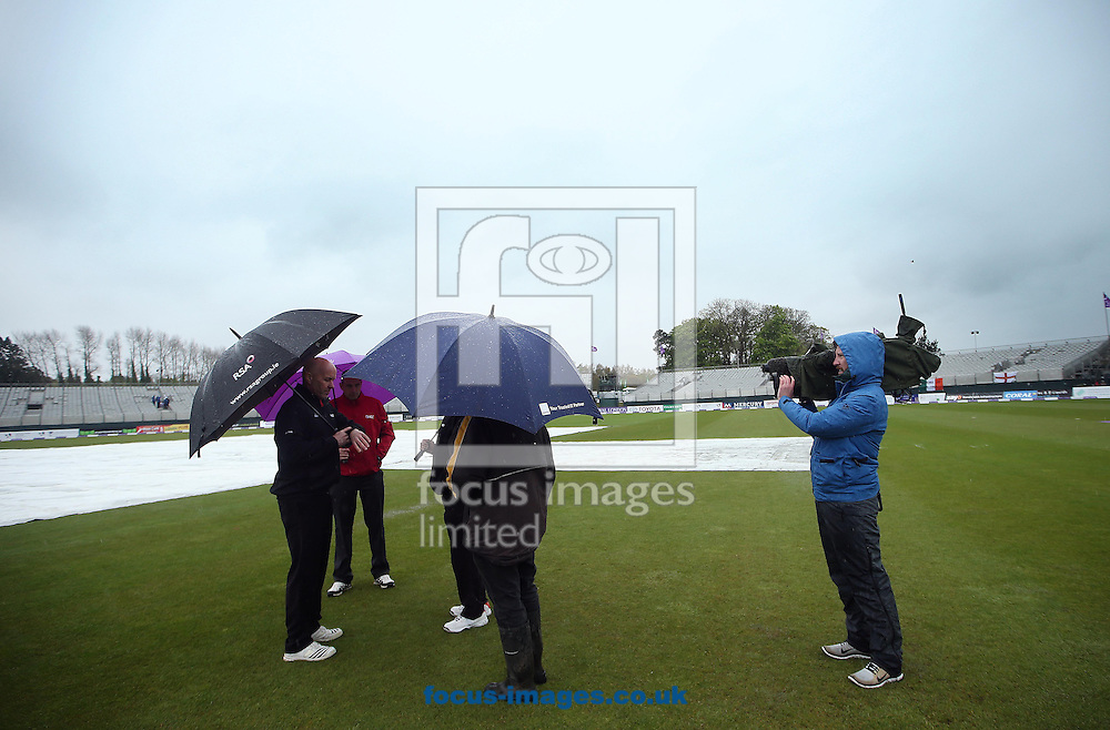 Umpires examine the pitch before the game is officially abandoned during the One Day International match at the Village, Malahide<br /> Picture by Lorraine O'Sullivan/Focus Images Ltd +353 872341584<br /> 08/05/2015
