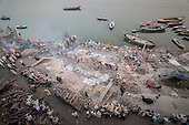 EXCLUSIVE Where funeral fires forever burn: Incredible photos show the 'Manikarnika Ghats' holy fest