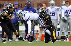 Nov 13, 2010; Columbia, MO, USA; Kansas State Wildcats quarterback Carson Coffman (14) is sacked by Missouri Tigers defensive back Carl Gettis (19) in the second half at Memorial Stadium. Missouri won 38-28. Mandatory Credit: Denny Medley-US PRESSWIRE