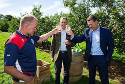 Bristol Rugby's Director of Rugby Andy Robinson and Bristol Sport CEO Andrew Billingham toast the new season as Thatcher's Cider Director Martin Thatcher looks on - Rogan Thomson/JMP - 29/07/2016 - PR - Myrtle Farm - Sandford, England - Bristol Sport Thatchers Visit.