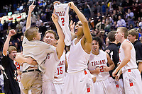 "Post Falls High's Shawn Reid celebrates his teams championship win while teammate Jared Kennedy lifts Anthony ""A-Train"" King during the jubilation Saturday following the game against Eagle High at the Idaho Center in Nampa. The win is the school's first boys basketball championship since 1964."