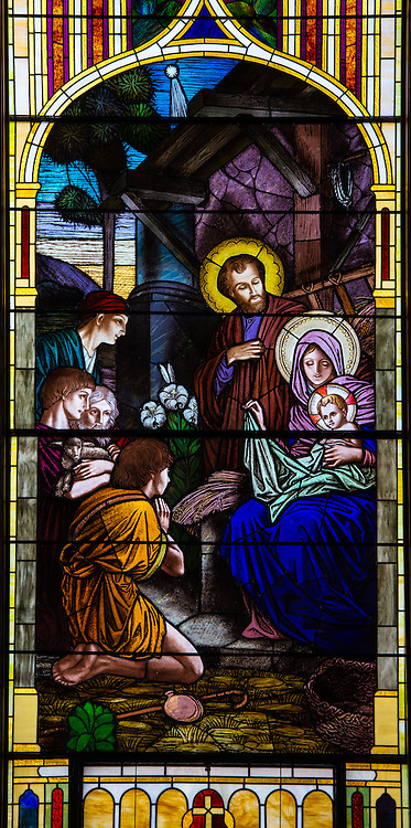 Stained glass image from St. James Church in Kellnersville, Wis., showing Holy Family at Jesus' birth. (Sam Lucero photo)