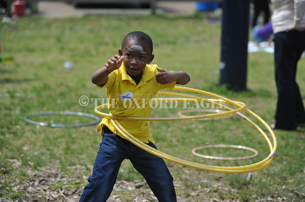 Devin Tanner tries three hula hoops at Party in the Park at Avent Park in Oxford, Miss. on Saturday, April 6, 2013. Vanderbilt won 2-1.