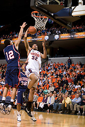 Virginia forward Mike Scott (32) goes up for a dunk against Richmond forward Kevin Smith (12).  The Virginia Cavaliers men's basketball team defeated the Richmond Spiders 66-64 in the first round of the College Basketball Invitational (CBI) tournament held at the University of Virginia's John Paul Jones Arena in Charlottesville, VA on March 18, 2008.